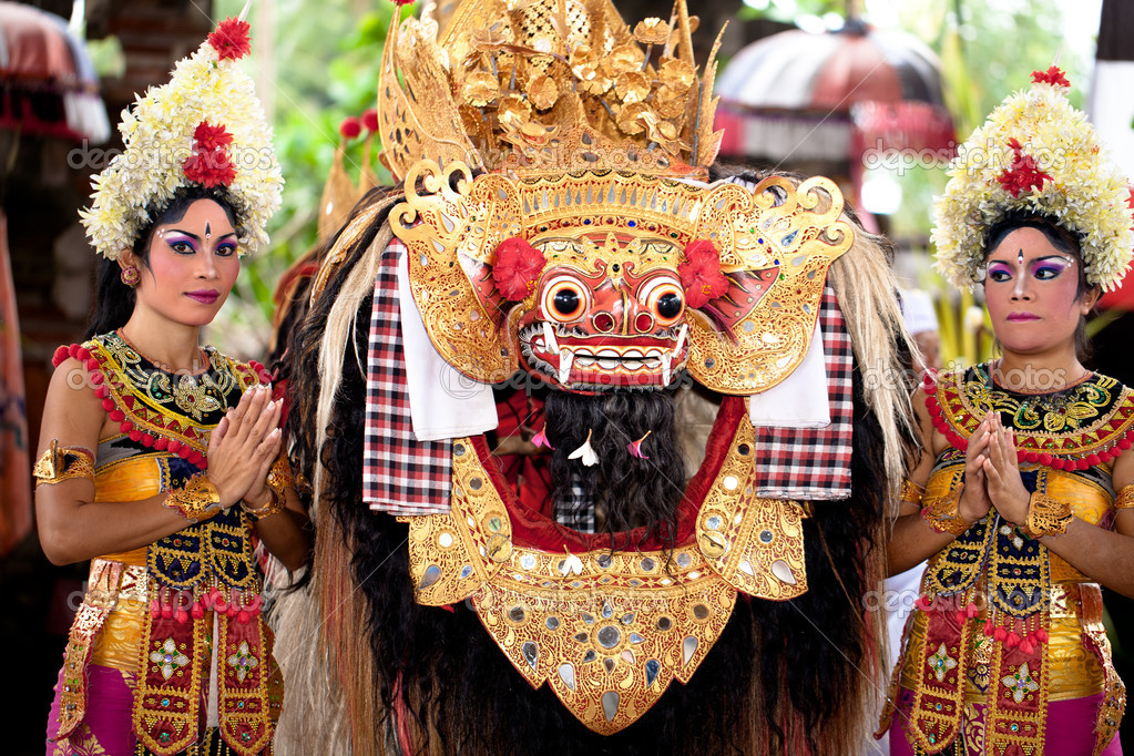 BATUBULAN, BALI, INDONESIA- JUNE 23: Unidentified women dance for turist at the weekly Barong Dance, the traditional balinese perfomance on June 23, 2011 in Batubulan, Bali, Indonesia.
